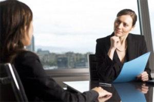 Women have meeting in boardroom
