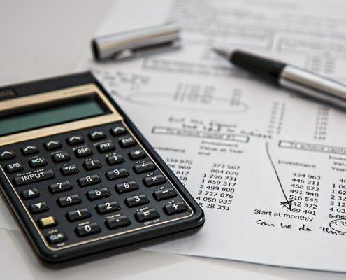 black calculator and silver pen on mathematical sheet