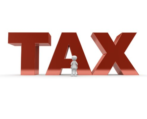 Red tax graphic with little white person standing in front